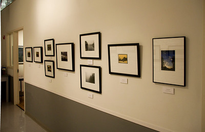 Closer view of framed photographs at other end of the Hall Gallery on the right side.