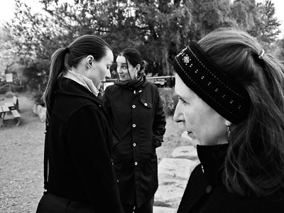 Three women in black coats, Seattle, Washington, 2009.