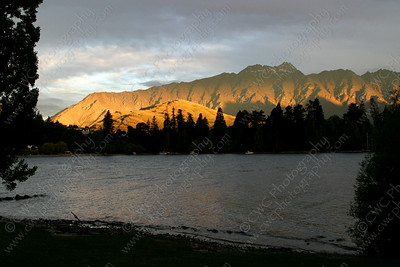 2080-Warm glow over the mountains and lake in Queenstown, New Zealand (8x12)