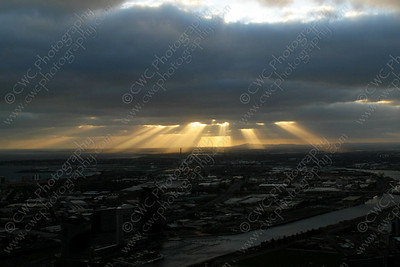 2050-Sunbeams shoot through the clouds in Melbourne, Australia (8x12)