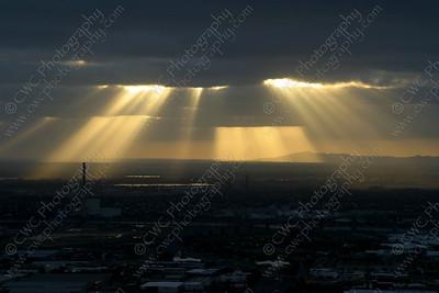 2110-Sunbeams shoot through the clouds in Melbourne, Australia (8x12)