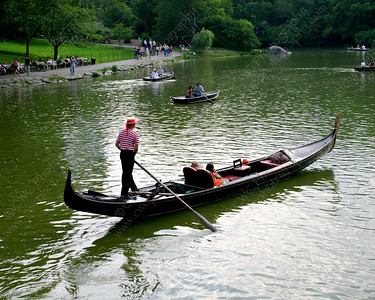 NEW! 6064-A Venetian-style gondola floats silently on a lake in Central Park (8x10)