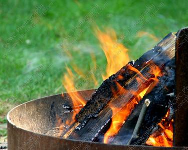 1190-A bright orange smoldering campfire (8x10)