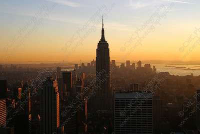 3050-The sun setting on the Empire State Building in New York City (8x12)