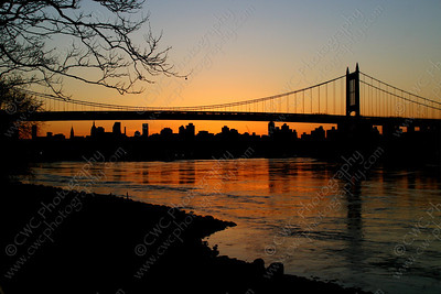 3010-A bridge silhouette during a sunset on the East River in New York City (8x12)