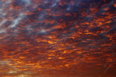 5050-Bright orange clouds during a sunset (8x12)