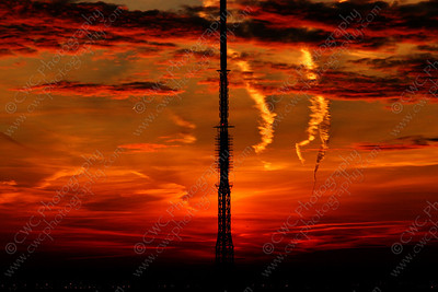 5060-Contrails pierce the red sky during a sunset (8x12)