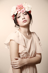 Fine art studio portrait of a beautiful woman with vintage porcelain makeup, created by Denver photographer Jason Sinn.