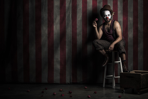 Fine art studio portrait of stage actor Anthony Simone posing as a lonely clown, created by Denver photographer Jason Sinn.