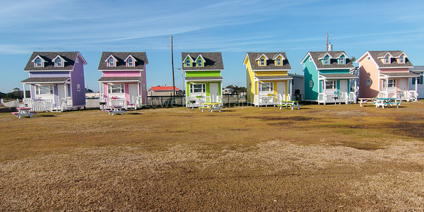 Neat colorful rental bungalows in Hatteras Village available in 12 x 24 print only
