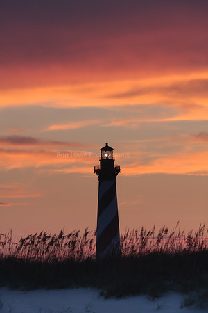 Cape Hatteras Lighthouse as sun disappears behind it