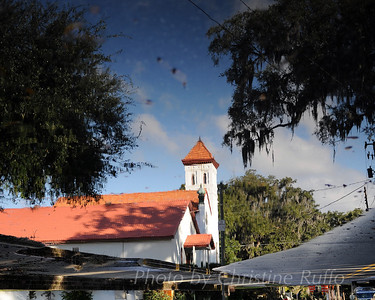 Temple Beth Tefilloh, Brunswick, Georgia, reflected in a puddle on Egmont Street
