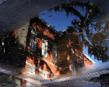 Annex Building, Glynn Academy, reflected in a puddle