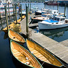 Along the waterfront of Gloucester Harbor, MA - Dories at the dock.  (c) Tom Croke/Visual Image, Inc.