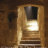 Some Hidden Glory  (1am) <br /> Taken deep in the bowels of the Mont Saint Michel Abbey which dates back to before 1000 CE. <br /> The strange thing is that i did not see the light when I was there. It appeared on the film. <br /> <br /> Some Hidden Glory by David Cale<br /> <br /> There is just beyond our grasp<br /> some hidden glory<br /> radiant with mystery<br /> <br /> A joy beyond perception<br /> beckons our souls<br /> brings hope to our lives<br /> even as we struggle to climb<br /> on wounded limbs<br /> with blinded eyes<br /> towards that which we can not know<br /> until our time is full