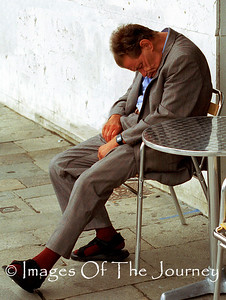 Crumpled I captured this photo in Venice in the early afternoon. Whether he was sleeping off a heavy lunch or just resting his body language is priceless.