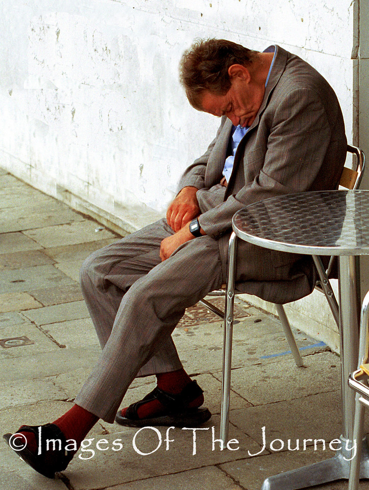Crumpled<br /> I captured this photo in Venice in the early afternoon. Whether he was sleeping off a heavy lunch or just resting his body language is priceless.