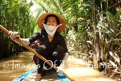 "Mekong Delta  This woman was our engine for our tour through this small part of the Mekong Delta designated ""separate tourist from money"" After this we had a dinner deep in the forest and then returned home ""relived"" of our tourist dollars. Actually it was a lot of fun."