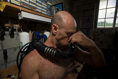 Dr. Kenny Broad prepares his rebreather for a dive in Abaco.