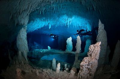 Brian Kakuk and Marc Laukien light up the room in Dan's Cave in Abaco.