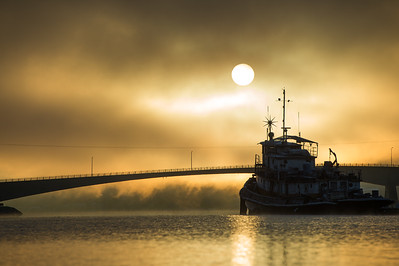 An old livaboard tug in the foggy sunrise. Gastineau Channel, Juneau, AK.