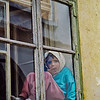 "<div class=""boxTop""><h3 id=""galleryTitle"" class=""title notopmargin"">Girl in Window, Sighisoara, Romania, 2000</h3> Color, 35mm.  At a street festival in Sighisoara, I noticed this girl watching the festival from her window while nibbling on lunch."
