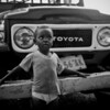 "<div class=""boxTop""><h3 id=""galleryTitle"" class=""title notopmargin"">Boy and Truck, Jamaica, 1998</h3> B&W 35mm.  I took this image in Mandeville, a mountain town that's ""real"" Jamaica, and quite different from the lavish coastal resorts."