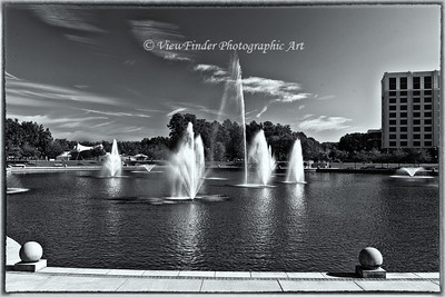 Fountains accented by a powerful sky make for a beautiful day in this downtown park.