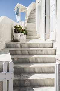 Beautiful marble stairs lead you up to a home in Firostefani.