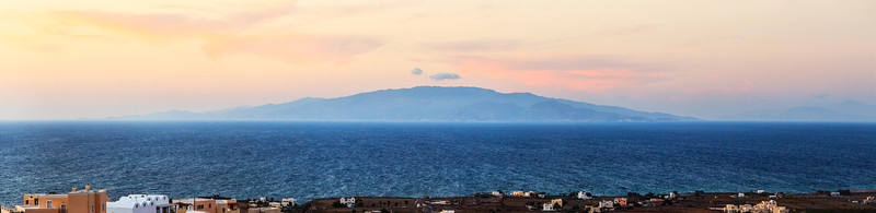 A panoramic view of Ios, a Greek island.  This view is from Oia in Santorini, Greece.