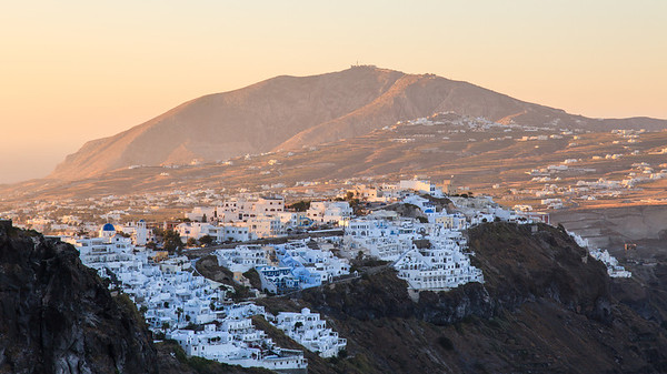 Sunrise over Fira in Santorini, Greece.