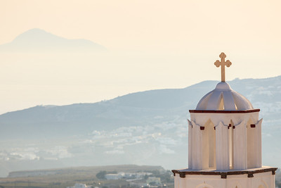 A church in Pyrgos overlooks the countryside below.  Pyrgos is a classical town on the island of Santorini, Greece.