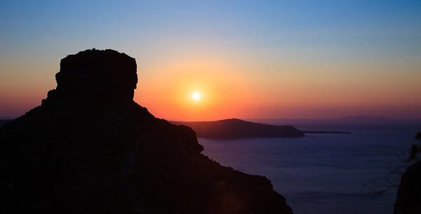Sunset view of Skaros Rock from Imerovigli in Santorini, Greece.