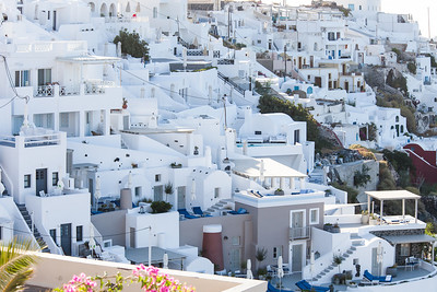 A view of the architecture lining the caldera in Firostefani Santorini.  Classic Greek style.