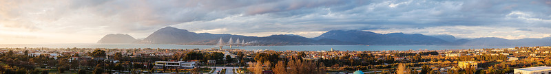 Panoramic view of Patra, Greece including Rio, the suspension bridge, and ports.