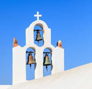 Church bells adorning one of the many churches in Sanotini, Greece.