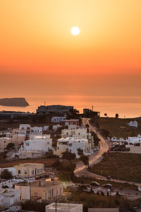 A beautiful sunset looking West from Pyrgos across the country side on the island of Santorini, Greece.