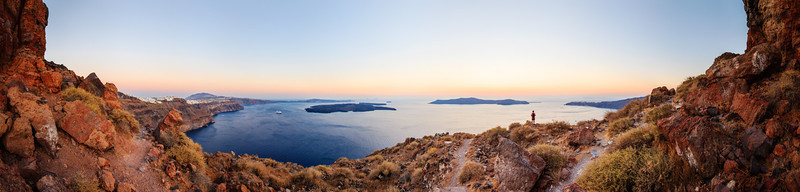 Panoramic view of the Caldera and Kameni Islands in Santorini, Greece.