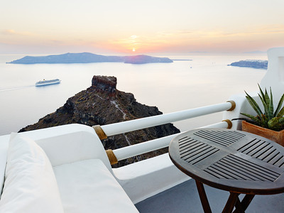 A gorgeous sunset overlooking the caldera from high on top Imerovigli on the island of Santorini, Greece.