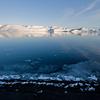 Black beach and frozen water