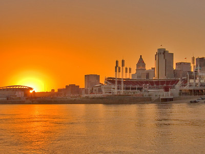 Downtown Cincinnati on the Ohio River riverfront at sunset.