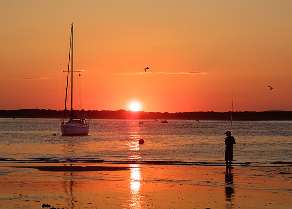 A young boy fishing on Plum Island beach, Newburyport MA