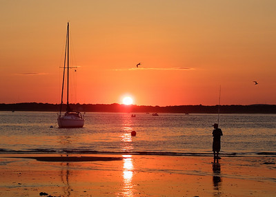A young boy fishing on Plum Island beach, Newburyport MA