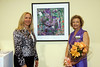 "September 9, 2009. With the bouquet from my radiation oncologist at the Courage Unmasked art auction, I'm standing with oral surgeon Harlene, who bought my mixed media radiation mask sculpture. I named it ""Blooming Passage"" in reference to my journey as a patient of oral cancer, and it now hangs in Harlene's office reception area."