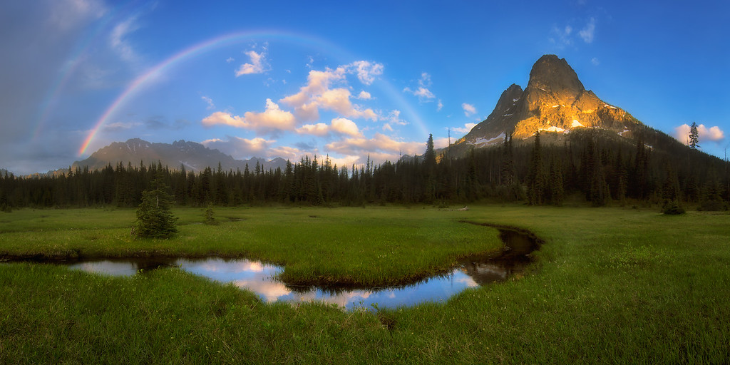 Photo of a full rainbow at Liberty Bell in the northern cascades, washington state