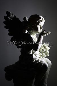 simply lit angel, once again testing radio triggers in dark room