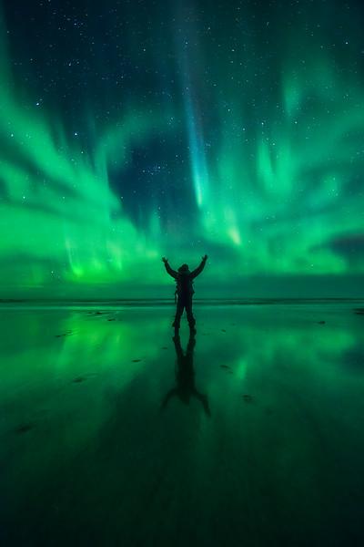 Photo selfie under the Aurora on a beach in Lofoten, Norway
