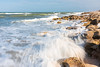 Waves crash on to the rocks at Washington Oaks Gardens beach, Florida