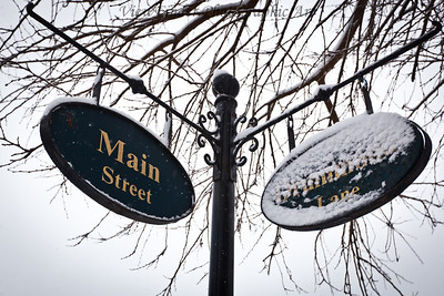Street signs point to a snowy day in Smithfield, VA