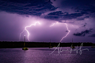 Heart shaped lightning over the boats in Noosa River.